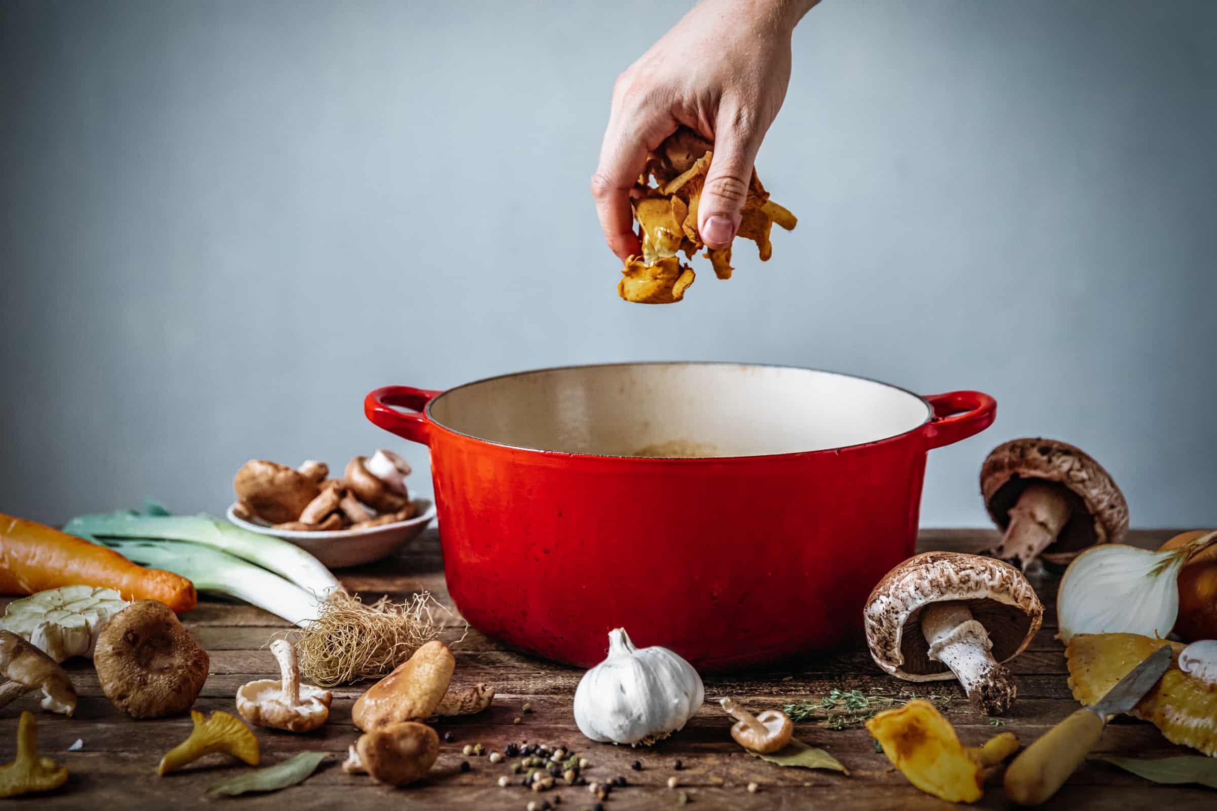 Adding mushrooms to the stock pot